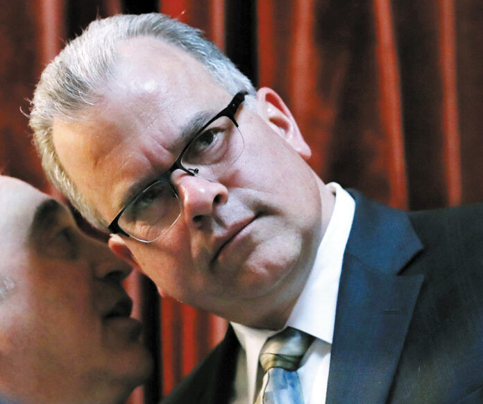 HOUSE SPEAKER NICHOLAS A. MATTIELLO, pictured during a legislative session in 2019, and Senate President Dominick J. Ruggerio answered questions at the Greater Providence Chamber of Commerce's annual legislative luncheon on Wednesday. / AP FILE PHOTO/CHARLES KRUPA