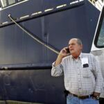 NEW BEDFORD company Blue Harvest announced it has reached an agreement to buy a dozen of boats belonging to Carlos Rafael, pictured above, along with his remaining permits for fish. / AP FILE PHOTO/JOHN SLADEWSKI/STANDARD TIMES