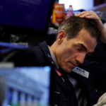 THE DOW Jones Industrial Average lost 1,582 points, or 6.1%, to start the day Monday. / AP FILE PHOTO/ RICHARD DREW