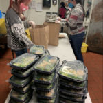 EMPLOYEES AT RED STRIPE restaurant in Providence organize meal packages to be delivered to Roger Williams Medical Center. Encore Restaurant Group and the Ocean State Job Lot Charitable Foundation recently launched its Meals with a Mission program where it will deliver close to 4,000 meals to frontline workers. / COURTESY ENCORE RESTAURANT GROUP