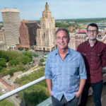 NEW MODEL: After working remotely due to the COVID-19 pandemic, Delin Designs CEO Eric Delin, left, and Digital Marketing Director Matt Smith decided not to return to in-office work and to perform all work remotely going forward. / PBN PHOTO/MICHAEL SALERNO