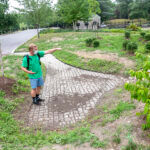 NATURAL CLEANSER: Ryan Kopp, coordinator of the Providence Stormwater Innovation Center, explains how a stormwater basin clears pollutants from runoff inside Roger Williams Park. / PBN PHOTO/MICHAEL SALERNO