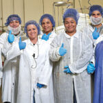 PREP WORK: Employees who work in Blount Fine Foods Corp.'s preparation room give a thumbs-up.COURTESY BLOUNT FINE FOODS CORP.