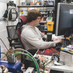 WIRED: Creative Conners Inc. software developer Christian Basse works on a project at his computer. / PBN FILE PHOTO/RUPERT WHITELEY