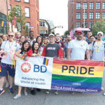 SHOWING PRIDE: Multiple Becton, Dickinson and Co. employees participate in a recent Providence PRIDE parade. / COURTESY BECTON, DICKINSON AND CO.