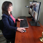 TEAMING UP: Karen Penticost, Envision Technology Advisors LLC vice president of development and operations, collaborates in real time with other Envision members on a Microsoft Teams meeting. / COURTESY ENVISION TECHNOLOGY ADVISORS LLC