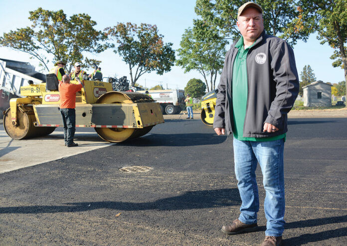 WAITING GAME: Local communities are growing frustrated waiting for a new state budget. Above, Joe Morais, project leader at the Pawtucket Department of Public Works, is among hundreds of city workers forced to file for unemployment one day each week. / PBN FILE PHOTO/ELIZABETH GRAHAM