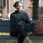STAYING ALERT: Harvard University graduate student Maya James received an email from a political action committee that seemed harmless: if you support Joe Biden, it urged, click here to check if you're registered to vote. A little research indicated that it was a phishing scam.  / AP PHOTO/MICHAEL DWYER