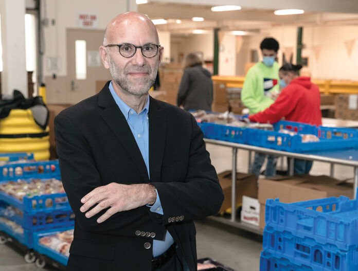GROWING NEED: Rhode Island Community Food Bank CEO Andrew Schiff has seen the number of individuals needing food increase from 53,000 to 68,000 people per month since March. / PBN PHOTO/TRACY JENKINS