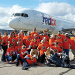 PULLING TOGETHER: Employees with Envision Technology Advisors LLC gather during their recent participation in the MS Jet Pull at T.F. Green Airport in Warwick. / COURTESY ENVISION TECHNOLOGY ADVISORS LLC