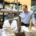 CRAFTSMEN: M.R.T. Jewelers President David Audette, right, looks on as jeweler Mario Antonio makes a piece at the East Providence jewelry store. / PBN PHOTO/RUPERT WHITELEY