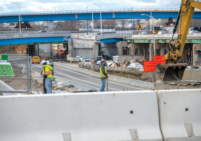 """UP-ROUTED: Construction workers are on-site at the Westminster Street overpass, part of the Route 6-10 connector project in Providence. Visible in the background is the """"flyover"""" bridge, a major feature of the new design for the busy exchange.  / PBN PHOTO/MICHAEL SALERNO"""