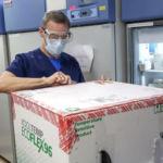 LIFESPAN CORP. Pharmacy Supervisor Richard Emery unpacks the first shipment of Moderna's COVID-19 vaccine to arrive at Rhode Island Hospital on Dec. 22. / LIFESPAN CORP./BILL MURPHY