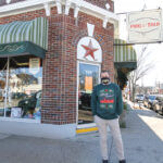 SIGN OF THE TIMES: Asher Schofield, co-owner of Frog & Toad LCC in Providence, has kept the retailer's two locations closed to foot traffic during the pandemic, but Frog & Toad has been able to offset that loss of business with online sales and curbside pickup.  / PBN PHOTO/PAMELA BHATIA