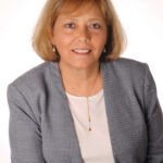 MAKING A DIFFERENCE: Phyllis Pelletier, chief financial officer of nonprofit Family Service of Rhode Island, says the example of giving back set by her father when she was young made a big impression on her and led to her wanting to work someplace where she could do the same. / COURTESY LUCA DEL BORGO