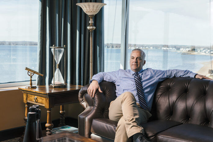THE RIGHT FIT: Michael Edwards, chief financial officer for Falvey Insurance Group Ltd. in North Kingstown, says the company has found a nice niche in a hard market period, as it's been able to grow its revenue 60% in the past three years.  PBN PHOTO/RUPERT WHITELEY