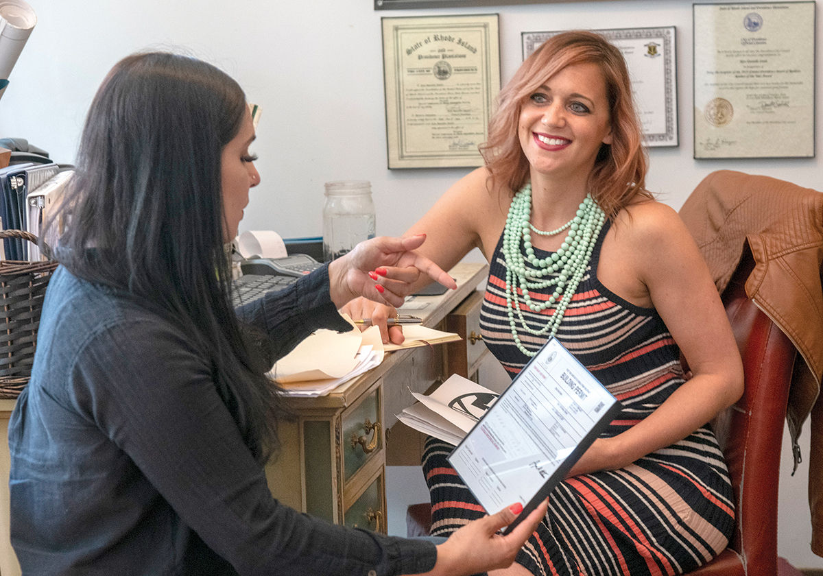 CHANGE-MAKER: Rita Danielle Steele, right, owner of Steele Realty Consultants International LLC, meets with Shamila Ahmed, an associate broker. / PBN FILE PHOTO/MICHAEL SALERNO