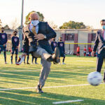 KICKING THINGS OFF: Narragansett Bay Commission Chairman Vin Mesolella kicks a soccer ball at the opening of a renovated Macomber Stadium in Central Falls, a joint project between the city and the Narragansett Bay Commission to transform contaminated land into a clean, usable facility. / COURTESY NARRAGANSETT BAY COMMISSION