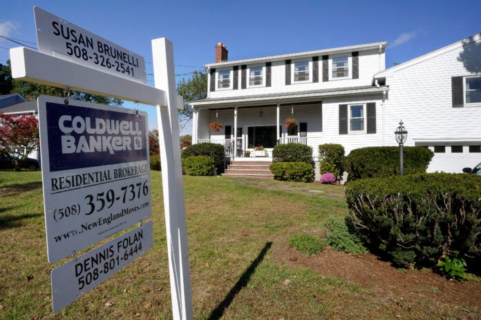 THE MEDIAN SALE price of a home in Bristol County, Mass. in May was $410,000. / AP FILE PHOTO/STEVEN SENNE