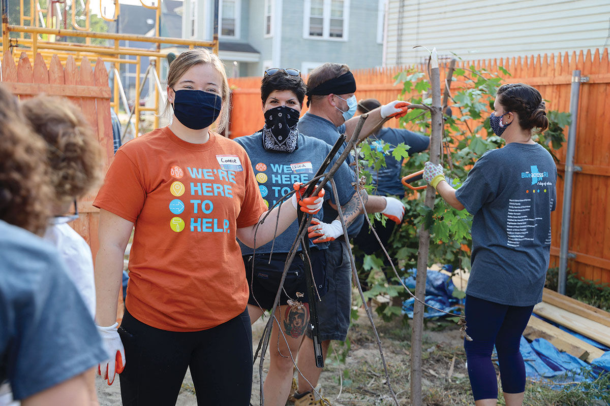 HOME SWEET HOME: During the company's ninth annual Blue Across Rhode Island Day, Blue Cross & Blue Shield of Rhode Island associates spend the day building a house with Habitat for Humanity of Greater Providence. / COURTESY BLUE CROSS & BLUE SHIELD OF RHODE ISLAND