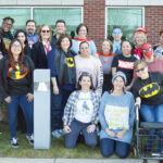 SUPERHEROES: Employees at Rhode Island Parent Information Network dress up as comic book superheroes at the office. / COURTESY RHODE ISLAND PARENT INFORMATION NETWORK