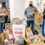 GIFT GIVING: RIKB Design Build team members raise donations for Toys for Tots of Rhode Island during the holiday season. / COURTESY RIKB DESIGN BUILD
