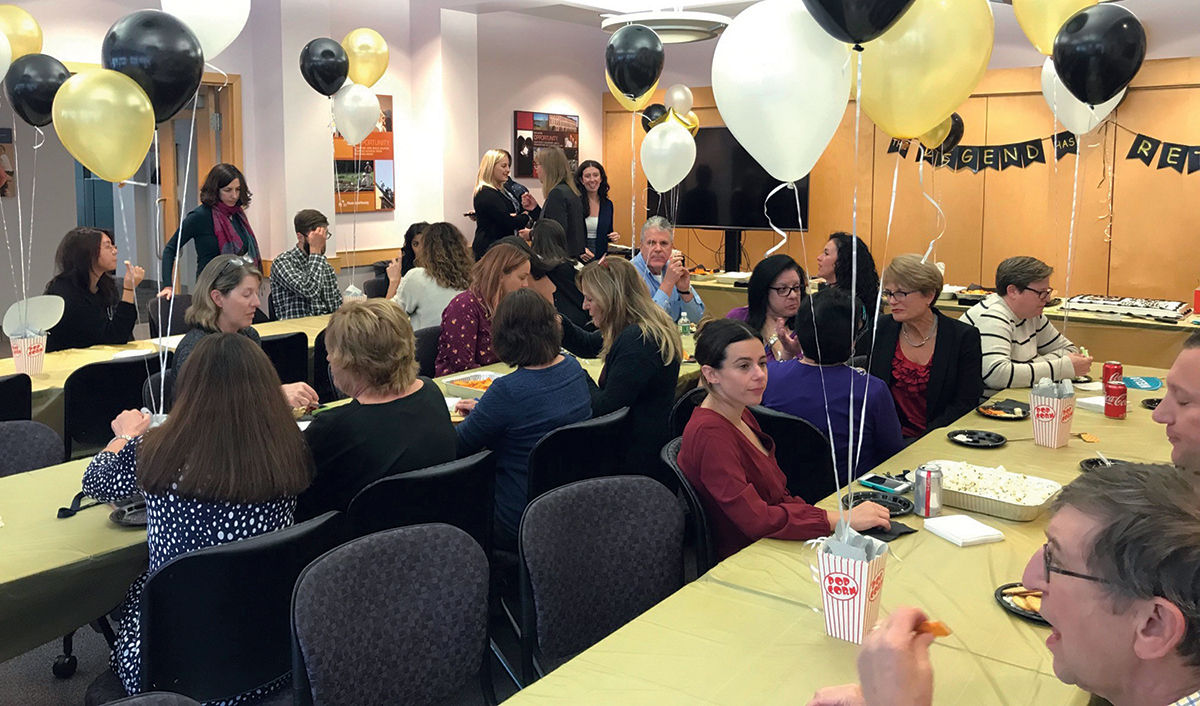 LET'S PARTY: R.I. Housing and Mortgage Finance Corp. employees celebrate and say goodbye to a retiring employee in January 2020. / COURTESY R.I. HOUSING AND MORTGAGE FINANCE CORP.