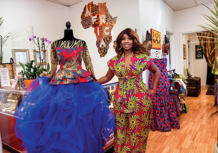 SITE VISITS: Geraldine Barclay King, owner of Geri's Bluffing Boutique in Woonsocket, says she wants to see business resources meet business owners where they are working to learn about their challenges and needs. / PBN PHOTO/MICHAEL SALERNO