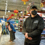 SPECIAL FLAVOR: Leo Lin, foreground, is the manager of Good Fortune Supermarket, a Providence grocery store that offers a wide variety of Asian foods. / PBN PHOTO/ELIZABETH GRAHAM