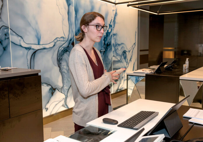 A PATIENT HOST: Erin Umbdenstock held out hope she'd get her job back when she was laid off from the Providence Marriott Downtown when the COVID-19 pandemic hit. It turned out better than that for her. / PBN PHOTO/MICHAEL SALERNO