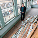 WORK SITE: Amy Grzybowski, future director of a planned higher education center in northern Rhode Island, visits the building in downtown Woonsocket that will be converted into the center by late 2021 or early 2022. / PBN PHOTO/MICHAEL SALERNO