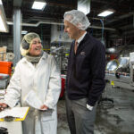 BLOUNT FINE FOODS CORP. CEO and President Todd Blount speaks with an employee at the company's Fall River facility. PBN FILE PHOTO/RUPERT WHITELEY