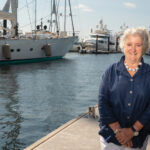 FULL CIRCLE: Susan Daly, vice president of strategy for the Rhode Island Marine Trades Association/Composites Alliance of Rhode Island, was raised in a sailing family and involved in competitive sailing since she was 11 but switched gears to pursue an art history degree in college, where she learned critical thinking and problem-solving – skills she says have helped her throughout her career. / PBN PHOTO/DAVE HANSEN