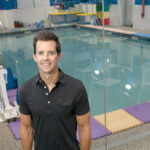 LEAP OF FAITH: Hoping to take advantage of what they saw as an untapped market, John Heelan and his wife, Beth, in 2015 opened Ripples Swim School, an aquatic operation providing swimming instruction for young children, with facilities in Bristol and West Warwick.  / PBN PHOTO/MICHAEL SALERNO