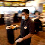 COMBINED COLLECTIONS of the local 1% meal and beverage and hotel taxes in Rhode Island increased 44.8% year over year in July. / AP FILE PHOTO/DAVID J. PHILLIP