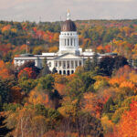 GETTING DULLER: Colorful foliage surrounds the Maine Statehouse in Augusta in 2017. Changing weather conditions have disrupted recent leaf-peeping season and could have a lasting effect on tourism in the region. / AP FILE PHOTO/ROBERT F. BUKATY