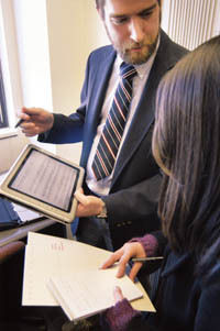 PBN photo/Frank Mullin<br><br> <b>GRADUATE STUDENTS</b> at Brown's new Microsoft Center for Pen-Centric Computing are working on new technologies such as the MusicPad, above, which allows composers to hand-write music notes on a tablet PC.