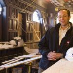 WILLIAM TRACEY, owner of TRAC Builders Inc., a general contractor and construction manager, says he doesn't want to limit the company to any one niche. Above, he stands in the bar area in the Dreyfus Hotel in Providence, which TRAC is rehabbing for AS220. /