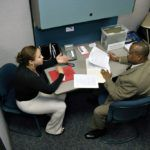 SPENCER POWER, right, a recruiter for Broadview Staffing Services, right, interviews Yohana Baez at the netWORKri career center in Providence. /
