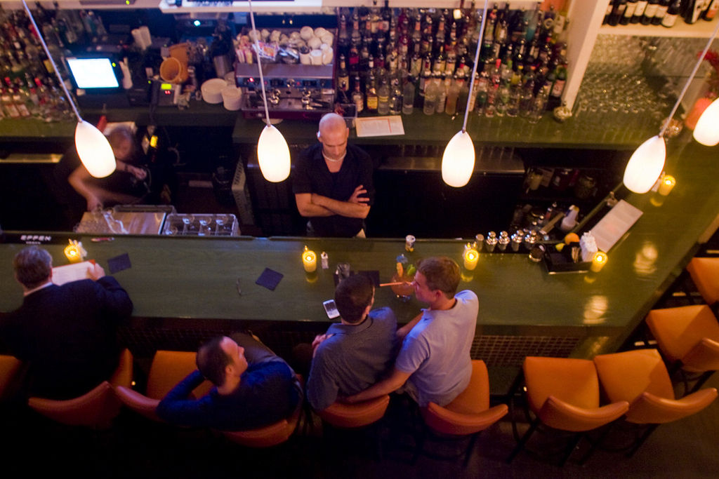 THE DOWNCITY, a longtime favorite with the local gay and lesbian community, reopened Sept. 7 at a new site, with an   expanded menu that includes cocktails named after well-known drag queens and other local characters. /