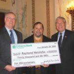 FROM LEFT: Joseph J. MarcAurele, president, Citizens Bank, Rhode Island; Warwick resident and Community Reinvestment Act award recipient Ray Neirinckx; and Gov. Donald L. Carcieri. /