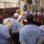 FOOD FOR THOUGHT: Amos Culinary Education program participants, shown above, receive 12 weeks of food preparation and safety training. /