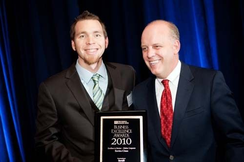 Enviro-Clean CEO, Eric Anderson, accepts the award for Excellence at a Mid-size Company.