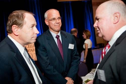 URI President David Dooley chats with executives from Citizens Bank.