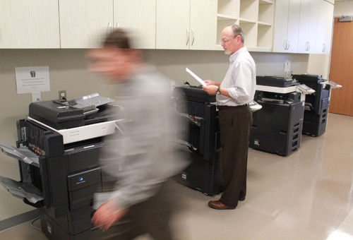 COURTESY BLUE CROSS AND BLUE SHIELD PRINTING MONEY: Peter Campbell, of Blue Cross & Blue Shield's strategic-marketing department, in one of the insurer's common print rooms, a consolidation which has reduced the firm's costs.