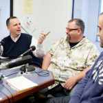 """BEHIND THE MIC: Pawtucket Mayor Donald R. Grebien, left, interviews city restaurateurs Jack Doherty and Brandon Harnois, right, for his weekly radio show, """"The Mayor's Corner."""" / PBN PHOTO/RUPERT WHITELEY"""