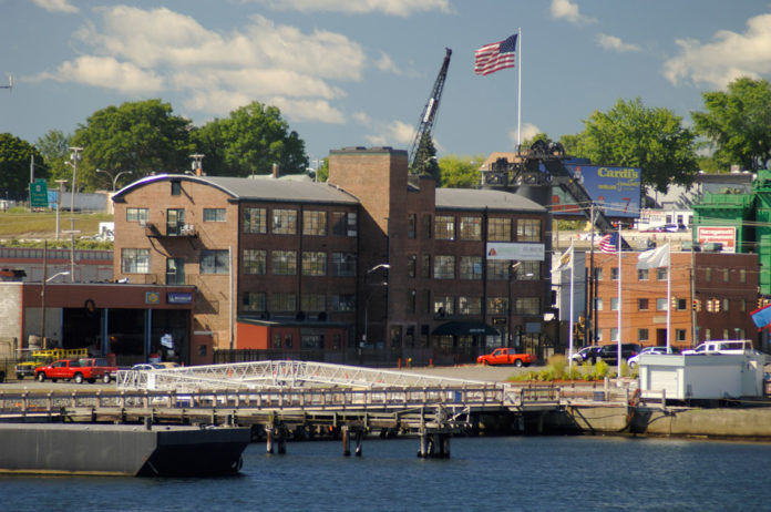 CONLEY'S PIER, a mixed-use development along Providence's Allens Avenue that included a 765-foot deep-water dock, has been purchased by National Grid, which intends to remediate the property before putting it to an unspecified use. / PBN FILE PHOTO/BRIAN MCDONALD