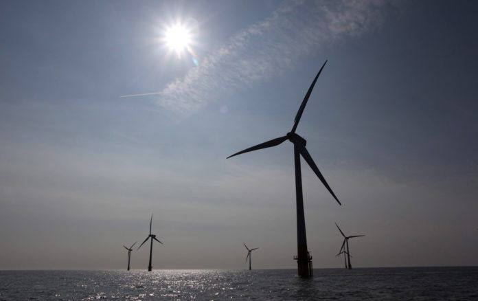 NSTAR agreed to buy power from the proposed Cape Wind offshore wind farm for more than double the cost of conventional sources, according to the Associated Press.  / BLOOMBERG FILE PHOTO/CHRIS RATCLIFFE