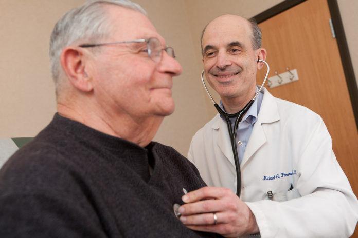 COASTAL MEDICAL Dr. Michael A. Pomerantz with a patient. / COURTESY COASTAL MEDICAL