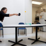 TOP ACTIVITY: Ryan's efforts have been designed for and by employees, and can include fun pastimes such as a mini-table tennis set where Rebecca Park, left, and Elizabeth Bryant partake. / PBN PHOTO/NATALJA KENT